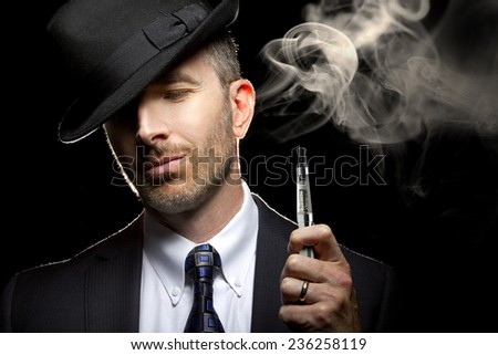 male smoking a vapor cigarette as an alternative to tobacco - stock photo