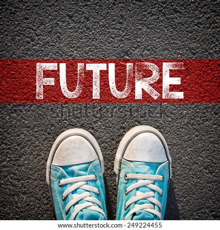Male sneakers and word future. Male sneakers on the asphalt road with drawn word future - stock photo