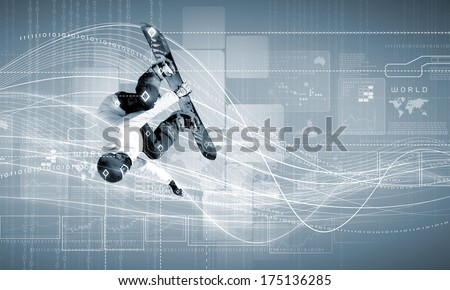 Male snowboarder making jump against media background - stock photo
