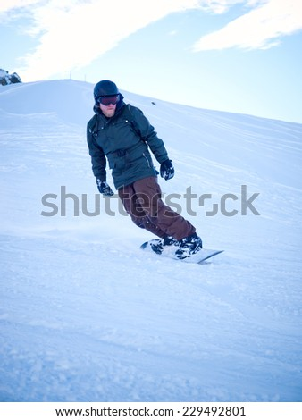Male snowboarder with helmet in the Austrian Alps - stock photo