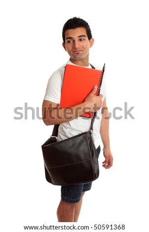 Male student carrying books,  looks over his shoulder. Suitable for your message. - stock photo