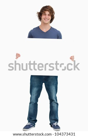 Male student holding a white board against white background - stock photo