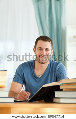 Male student reviewing his subject material