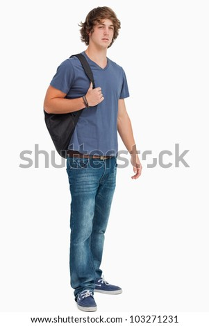 Male student with a backpack against white background