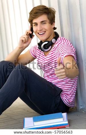 Male student with thumbs up - stock photo