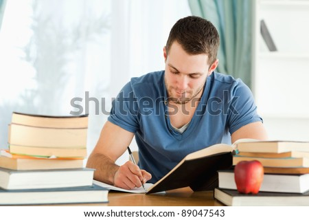 Male student working through his books