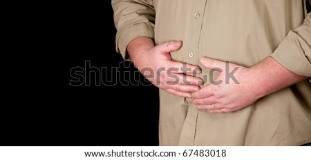 male suffering from stomach pain - stock photo