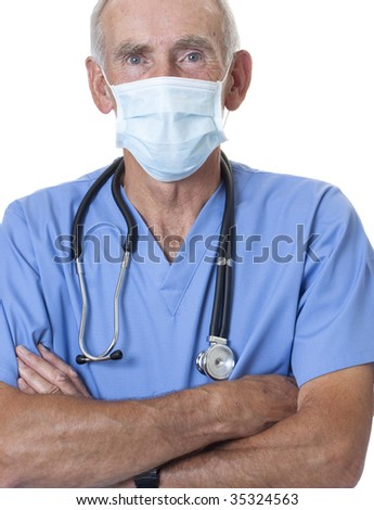 Male surgeon in scrubs and mask