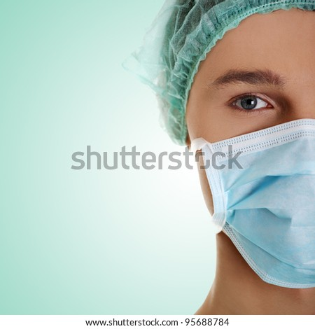 Male surgeon looking at camera at hospital, close up shot - stock photo