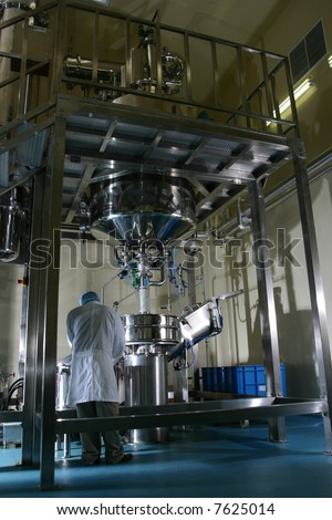 Male technician inspecting operation of valves in boiler room of power station - stock photo