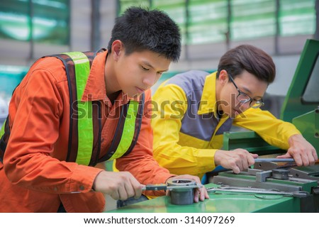 male technician machinist worker adjusting and repair machine in production line, factory concept - stock photo