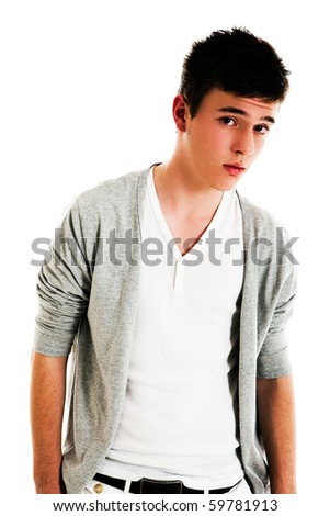 Male teen with an open sweater looks towards the camera with a quizzical look upon his face. Isolated on white. Vertical shot. - stock photo