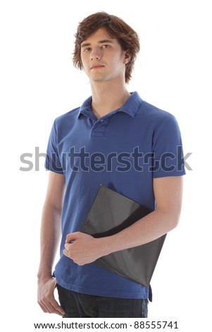 Male teenage Student holding a folder - stock photo