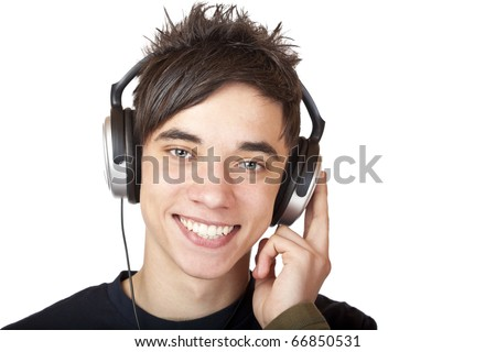 Male Teenager listening to music and smiles happy. Isolated on white background.