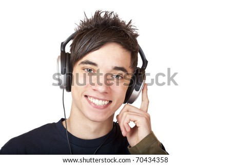 Male Teenager listening to music and smiles happy. Isolated on white background. - stock photo