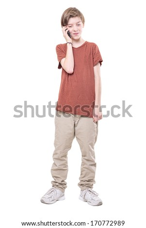 male teenager on the phone, isolated on white. - stock photo