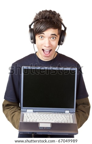 Male Teenager with earphones makes mp3 music download with computer. Isolated on white background.