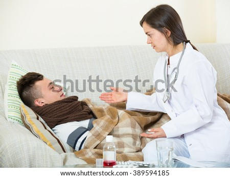 Male teenager with flue and professional therapeutist at home