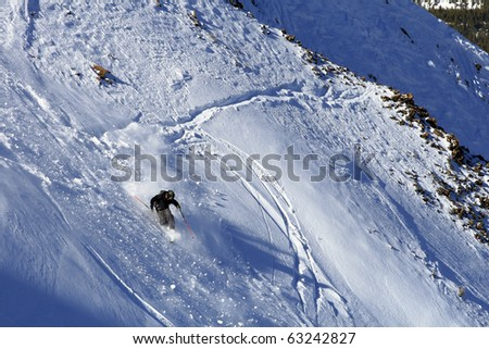 Male Telemark Skier on a steep run - stock photo