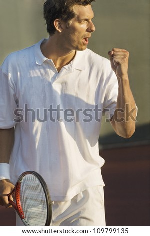 Male tennis player celebrating success