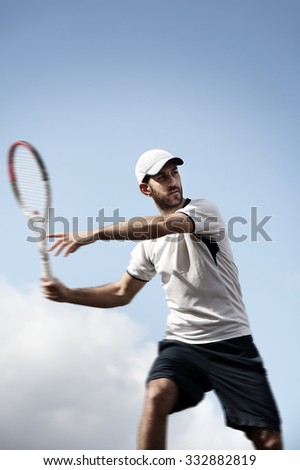 male tennis player in action - stock photo