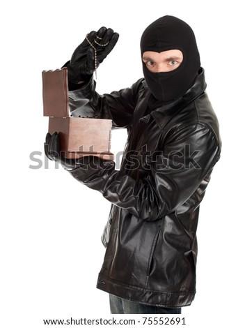 male thief in balaclava with jewelry box - stock photo