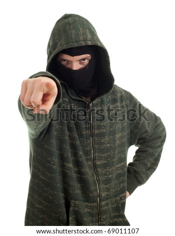 male thief in mask and hood pointing you - stock photo
