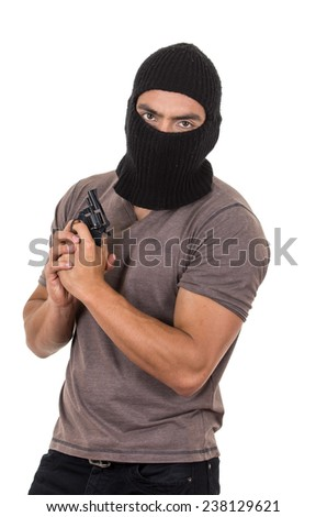 male thief wearing mask and holding gun pointing up isolated on white