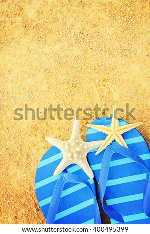 Male thongs on the sand beach with sea  background