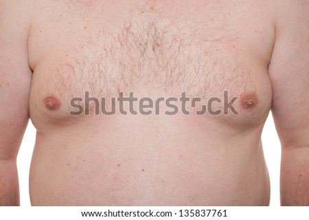 Male thorax showing early stage Gynecomastia or man boobs also a symptom of obesity - stock photo