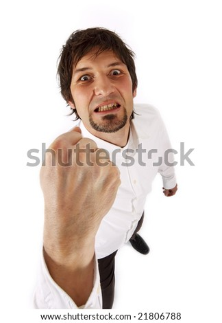 male threatening with his fist - funny white angle perspective (isolated on white) - stock photo