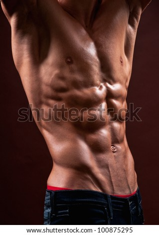 Male torso with strong abs - stock photo