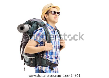 Male tourist with backpack walking isolated on white background - stock photo