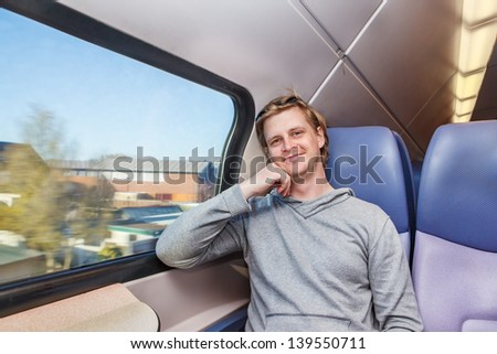 Male traveler in a train - stock photo