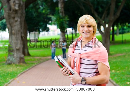 male university student in campus - stock photo