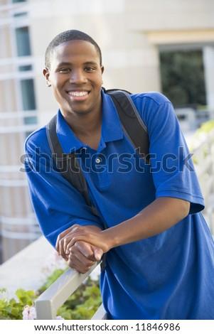 Male university student outside wearing rucksack - stock photo