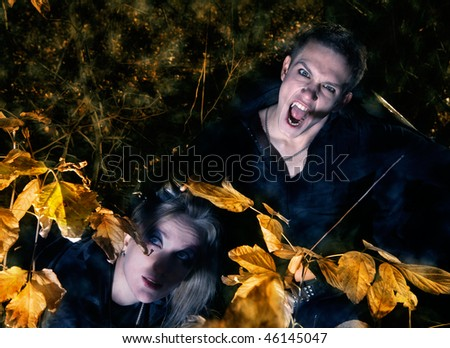 male vampire and beautiful witch - stock photo
