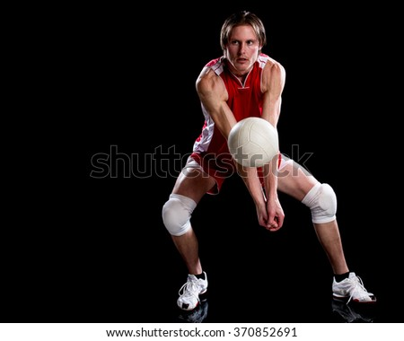 Male volleyball player. Studio shot over black. - stock photo