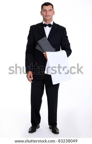 Male waiter stood holding menu - stock photo