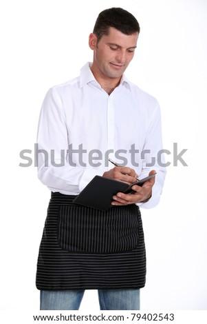 Male waiter taking order - stock photo