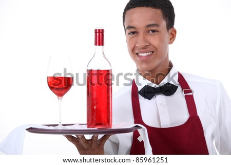 Male waiter with wine on tray - stock photo