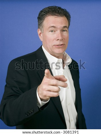 male wearing a black suite gesturing with his finger as if ready to launch into a discussion - stock photo