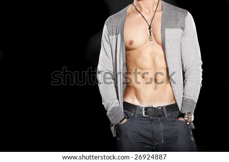 male wearing unbuttoned sweater to show stomach - stock photo