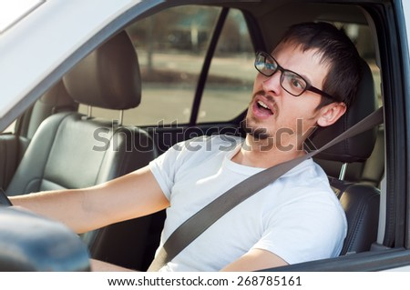Male white driver is scared in traffic accident - stock photo