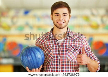 Male with bowling ball in club - stock photo