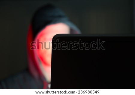 Male with criminal and sexual intentions at a computer and on the internet. - stock photo