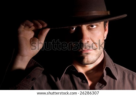 Male with hat  and piercing eyes - stock photo
