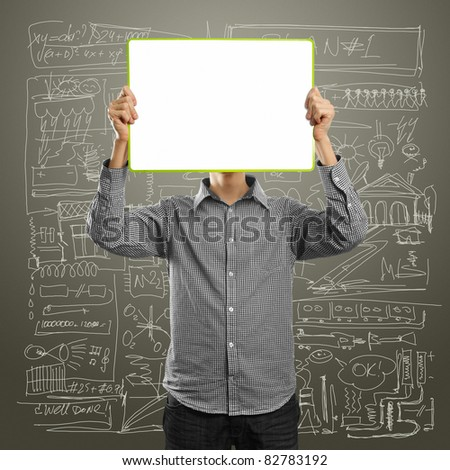 male with write board in his hands against his head - stock photo