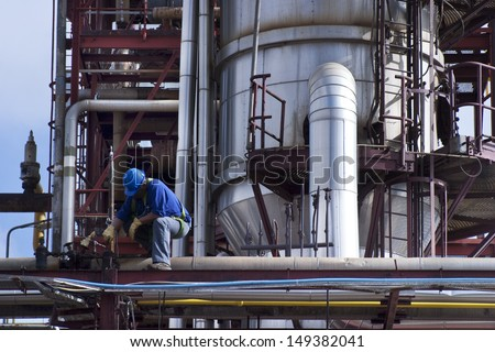 Male worker at industrial plant - stock photo