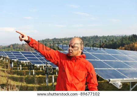 Male worker at solar panel field